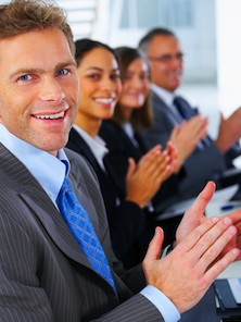 people clapping at meeting